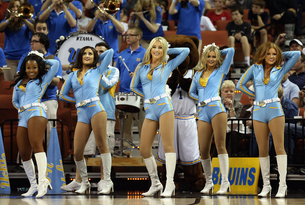 . AUSTIN, TX - MARCH 22:  UCLA Bruins cheerleaders cheer at the game against the Minnesota Golden Gophers during the second round of the 2013 NCAA Men\'s Basketball Tournament at The Frank Erwin Center on March 22, 2013 in Austin, Texas.  (Photo by Stephen Dunn/Getty Images)