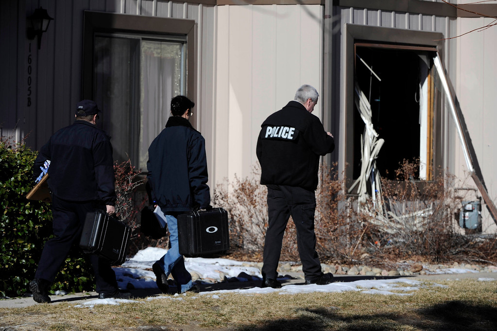 . Aurora Police investigators start their work at a crime scene at 16005 Ithaca Place in Aurora Saturday afternoon. The bodies of four people, including a gunman are dead at the scene following a standoff situation early Saturday morning. The Denver Post/ Andy Cross
