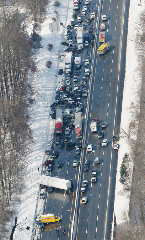 . A huge pileup, seen in an aerial photo, shut down part of the Pennsylvania Turnpike in Bensalem, Pa., on Friday, Feb. 14, 2014. An estimated 50 to 100 vehicles were involved after crashes on the slushy roadway. (AP Photo/Philadelphia Inquirer, Michael S. Wirtz)