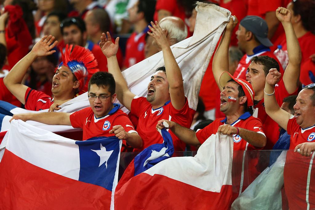 . Chile fans cheer during the 2014 FIFA World Cup Brazil Group B match between Chile and Australia at Arena Pantanal on June 13, 2014 in Cuiaba, Brazil.  (Photo by Clive Brunskill/Getty Images)