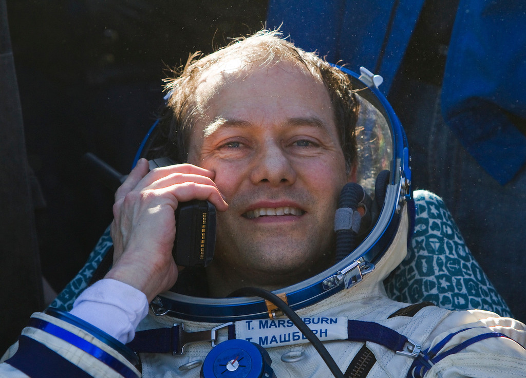 . U.S. astronaut Thomas Marshburn speaks on the phone after the Russian Soyuz space capsule landed some 150 kilometers (94 miles) southeast of the town of Dzhezkazgan in central Kazakhstan, Tuesday, May 14, 2013.  (AP Photo/ Sergei Remezov, Pool)