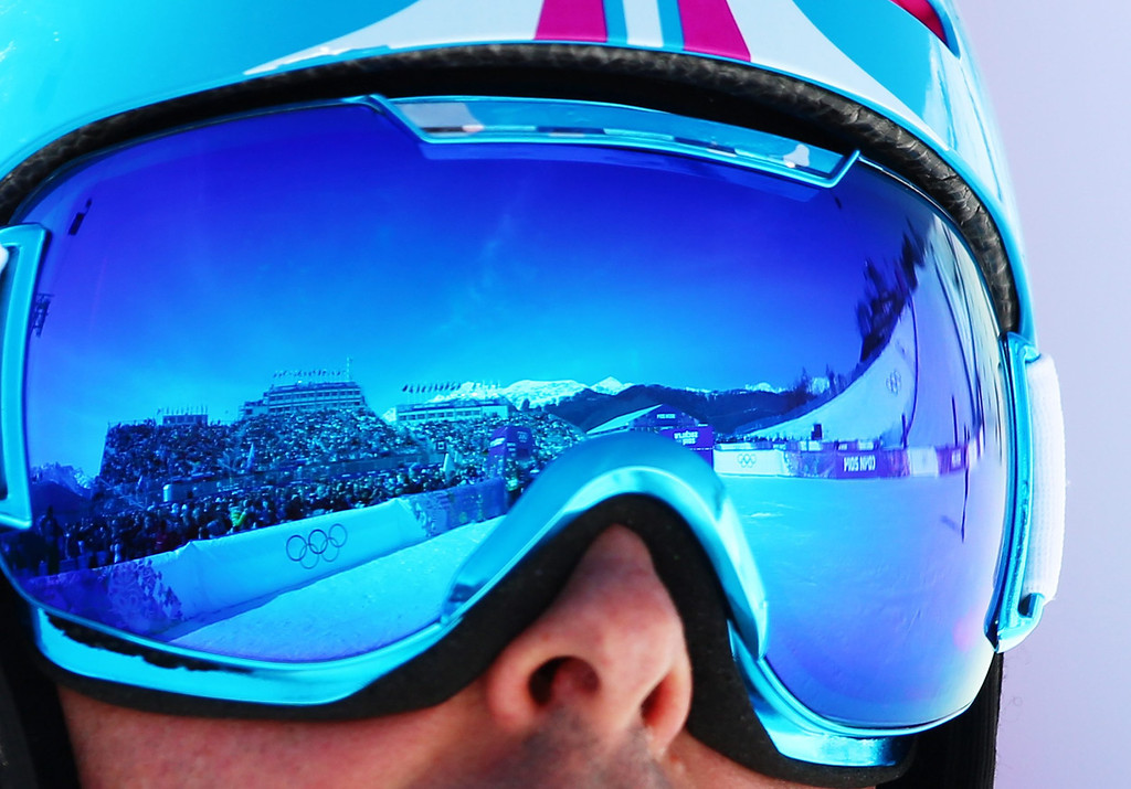 . The stadium is mirrored in his goggles in the 1/8 finals of the menës Snowboard Parallel Slalom at Rosa Khutor Extreme Park at the Sochi 2014 Olympic Games, Krasnaya Polyana, Russia, 22 February 2014.  EPA/JENS BUETTNER