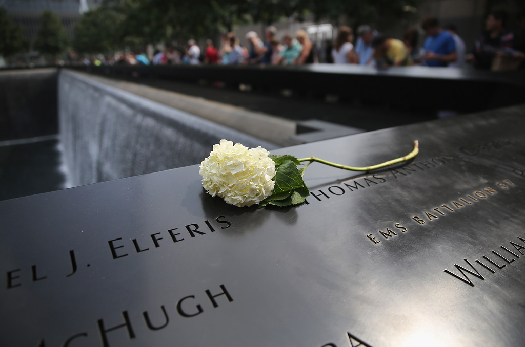 . NEW YORK, NY - SEPTEMBER 10:  A flower lies atop names of victims at the 9/11 Memorial on September 10, 2013 in New York City. Tomorrow marks the 12th anniversary of the attacks of September 11, 2001 that killed almost 3,000 people. The 9/11 Memorial has become a major tourist attraction for visitors to New York City.  (Photo by John Moore/Getty Images)
