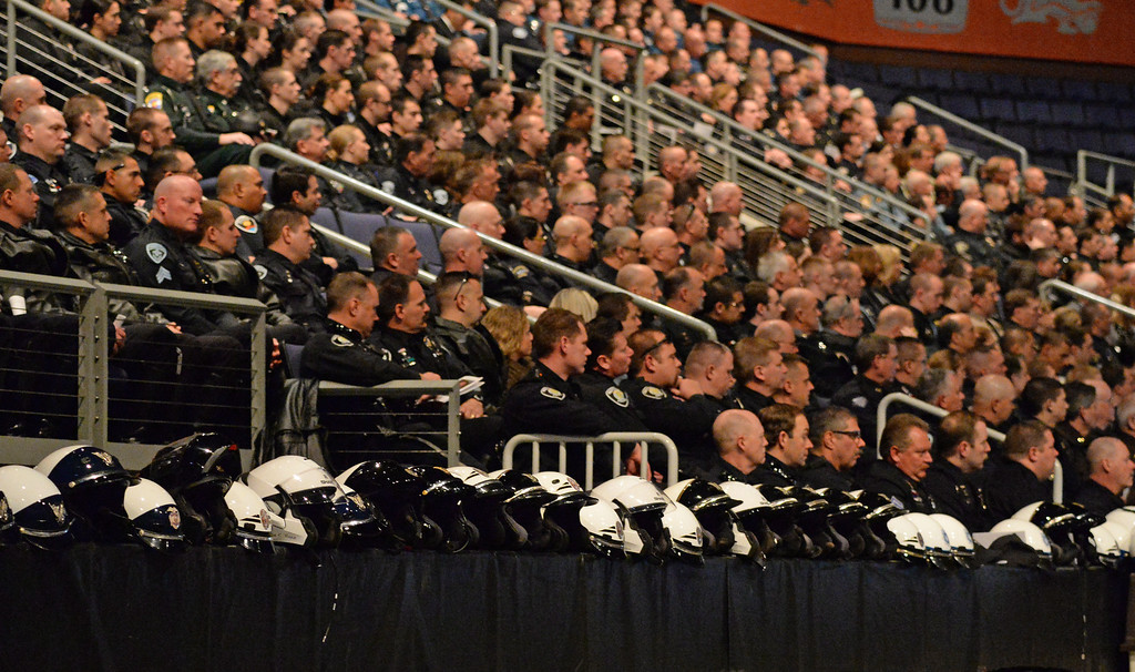 . Motorcycle helmets line the wall as police officers from around the state came for the funeral of Sgt. David Baldwin at the First Bank Events Center in Broomfield, February, 03 2014. Baldwin was on motorcycle patrol riding north on Colorado 93 on Sunday morning when he was hit by a vehicle that crossed the double-yellow line. (Photo by RJ Sangosti/The Denver Post)