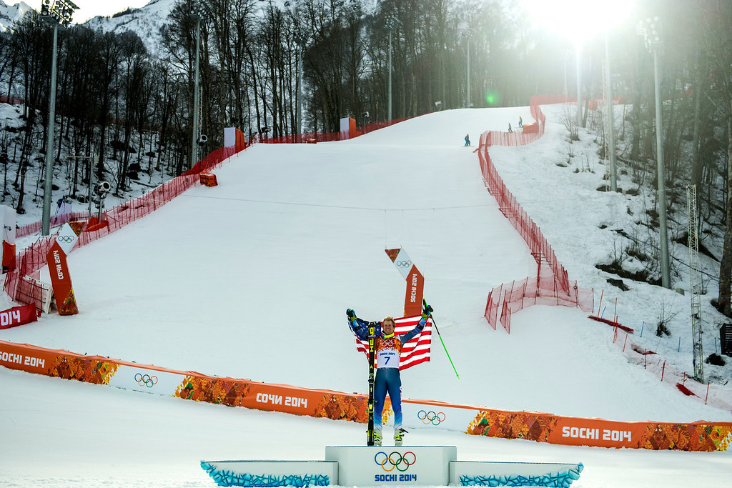 . KRASNAYA POLYANA, RUSSIA  - JANUARY 19: Ted Ligety, of Park City, celebrates with an American flag after winning the Men\'s Giant Slalom at Rosa Khutor Alpine Center during the 2014 Sochi Olympics Wednesday February 19, 2014. LIgety won the gold medal with a cumulative time of 2:45.29. (Photo by Chris Detrick/The Salt Lake Tribune)