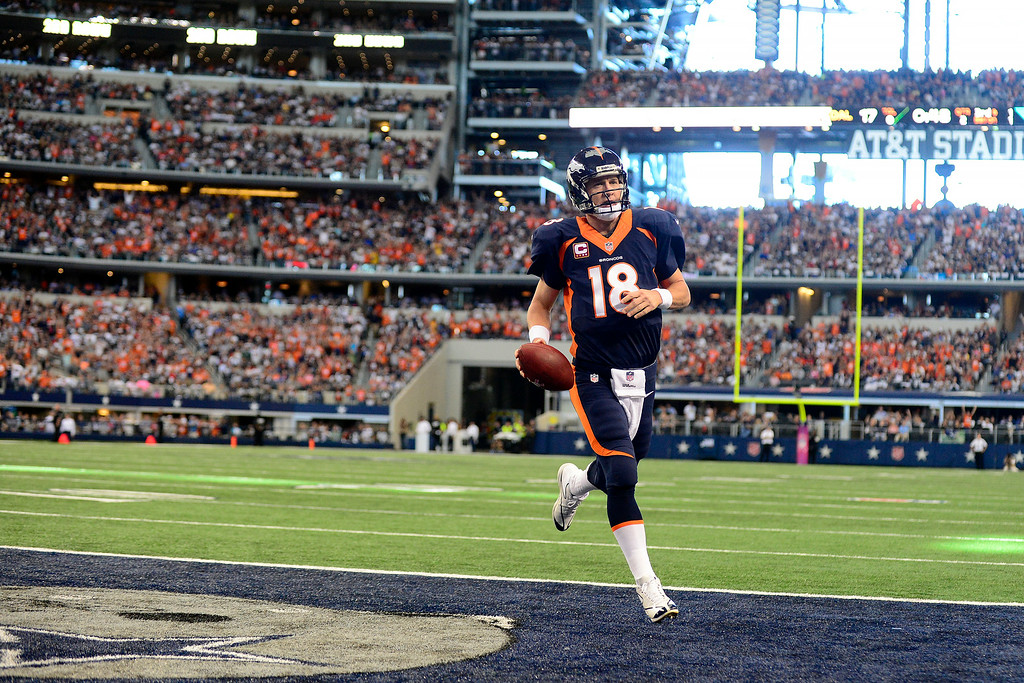 . Peyton Manning easily finds his way into the end zone for a touchdown against the Cowboys. (AAron Ontiveroz/The Denver Post)