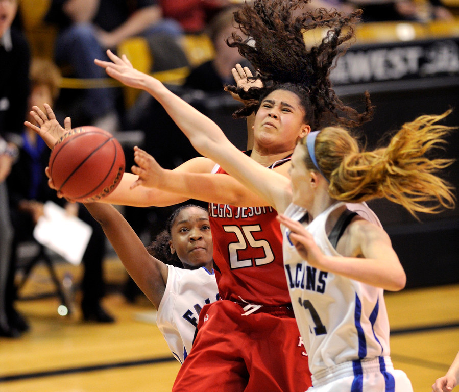 . BOULDER, CO. - MARCH 16: Raiders junior forward Kelsi Lidge (25) drove the lane in the first half. The Regis Jesuit High School girl\'s basketball team took on Highlands Ranch in the 5A championship game Saturday, March 16, 2013 at the Coors Events Center in Boulder.  (Photo By Karl Gehring/The Denver Post)