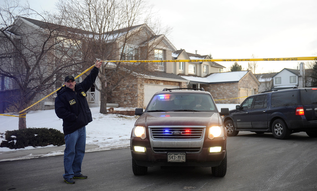 . HIGHLANDS RANCH, CO - DECEMBER 13 :  Law enforcement officials move a vehicle at the home of the school shooting suspect   on Friday, December 13, 2013.  (Photo By Cyrus McCrimmon/The Denver Post)
