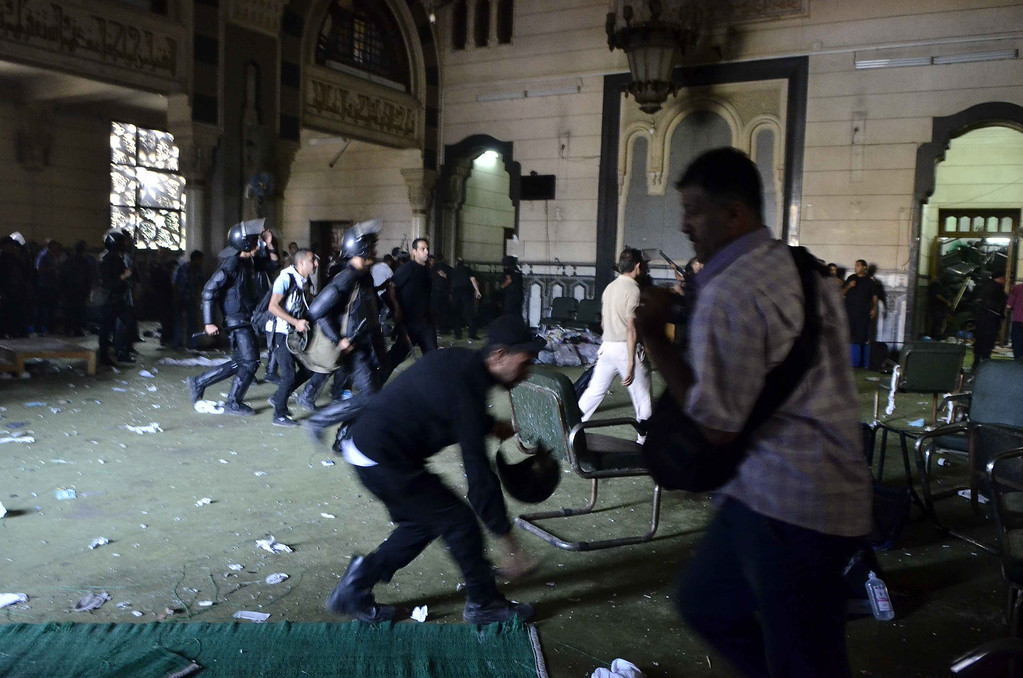 . Egyptian riot policemen get in the community services hall of Cairo\'s Al-Fath mosque where Islamist supporters of ousted president Mohamed Morsi hole up on August 17, 2013. The standoff at al-Fath mosque in central Ramses Square began on August 16, with security forces surrounding the building where Islamists were sheltering and trying to convince them to leave. MOHAMED EL-SHAHED/AFP/Getty Images