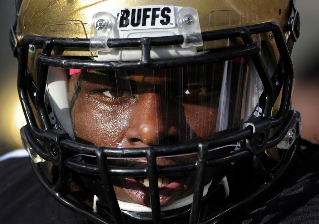 . BOULDER, CO - NOVEMBER 16: Senior Derrick Webb, a linebacker for the Colorado Buffaloes football team, takes the field for warm-up drills before the start of the game against the University of California at Folsom Field in mid-November. (Photo by Kathryn Scott Osler/The Denver Post)