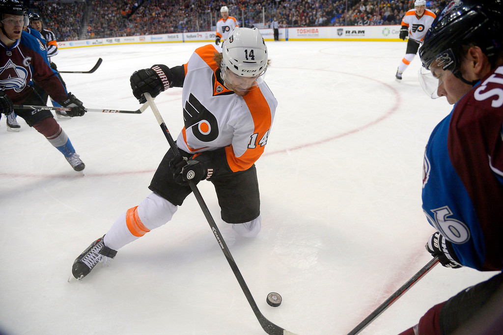 . Philadelphia Flyers center Sean Couturier (14) battles for the puck with Paul Stastny during the first period January 2, 2014 at Pepsi Center. (Photo by John Leyba/The Denver Post)