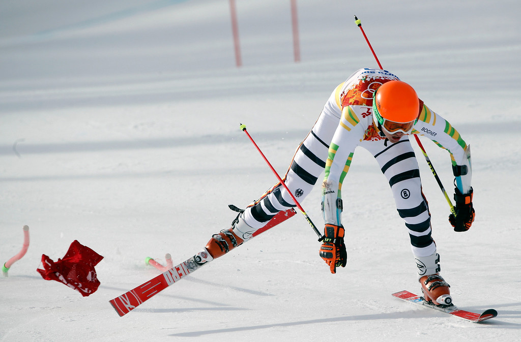 . Germany\'s Stefan Luitz stumbles after catching his ski in a gate in the first run of the men\'s giant slalom at the Sochi 2014 Winter Olympics, Wednesday, Feb. 19, 2014, in Krasnaya Polyana, Russia. (AP Photo/Christophe Ena)