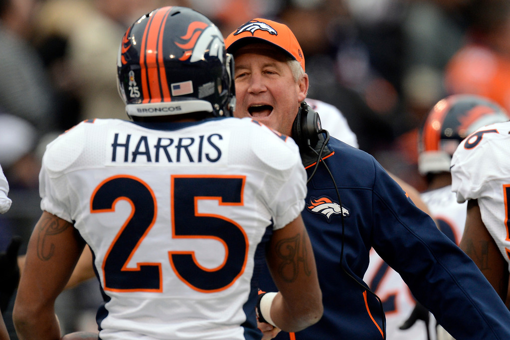 . Denver Broncos cornerback Chris Harris #25  and head coach John Fox after his run back of an interception for a touchdown at the M&T Bank Stadium, in Baltimore , MD Sunday December 16, 2012.      Joe Amon, The Denver Post