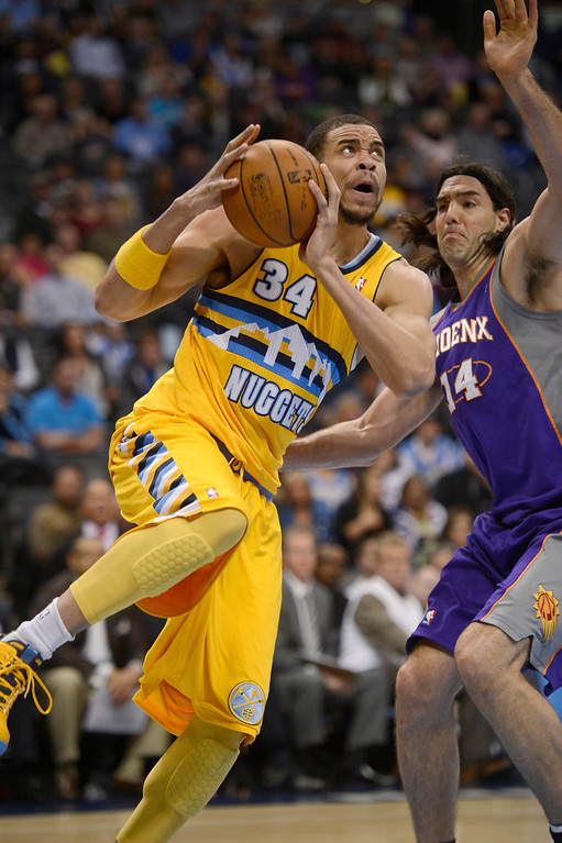 . JaVale McGee (34) of the Denver Nuggets drives pas Luis Scola (14) of the Phoenix Suns during the first quarter for a basket April 17,  2013 at Pepsi Center. (Photo By John Leyba/The Denver Post)