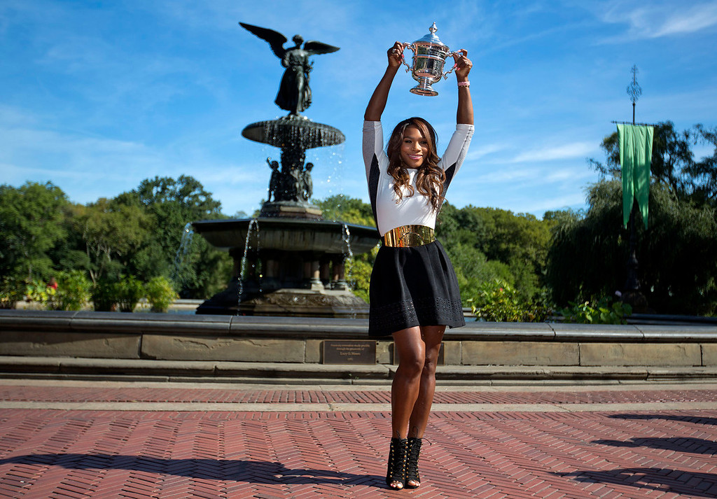. 2013 U.S. Open Women\'s Singles tennis champion Serena Williams poses with her trophy in Central Park, Monday, Sept. 9, 2013, in New York. Williams defeated Victoria Azarenka 7-5, 6-7 (6), 6-1 on Sunday. (AP Photo/David Goldman)