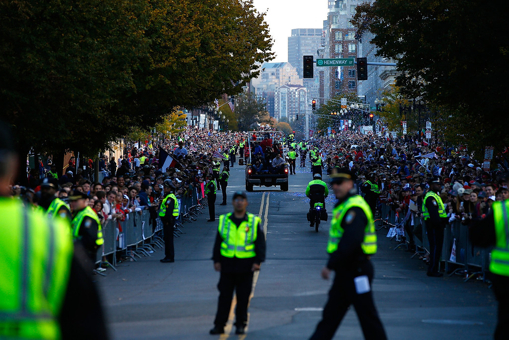 . BOSTON, MA - NOVEMBER 02: Members of the Boston Police Department prepare for the floats carrying members of the Boston Red Sox to travel down Boylston Street during the World Series victory parade on November 2, 2013 in Boston, Massachusetts.  (Photo by Jared Wickerham/Getty Images)