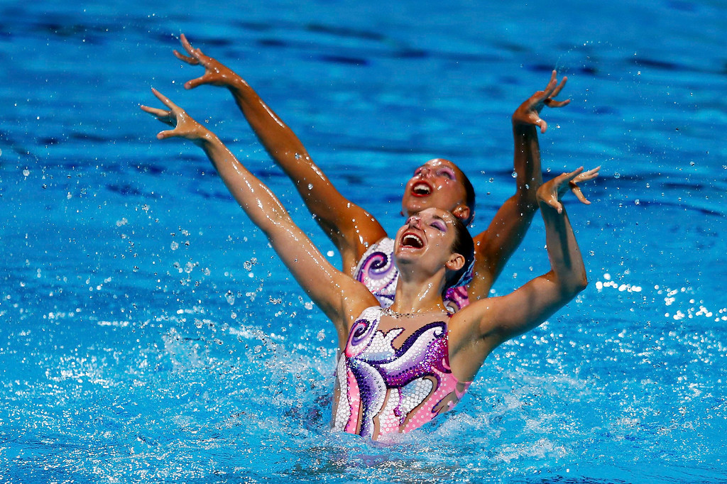 . Switzerland\'s Pamela Fischer and Anja Nyffeler perform in the synchronised swimming duet technical routine final during the World Swimming Championships at the Sant Jordi arena in Barcelona July 21, 2013.  REUTERS/Michael Dalder