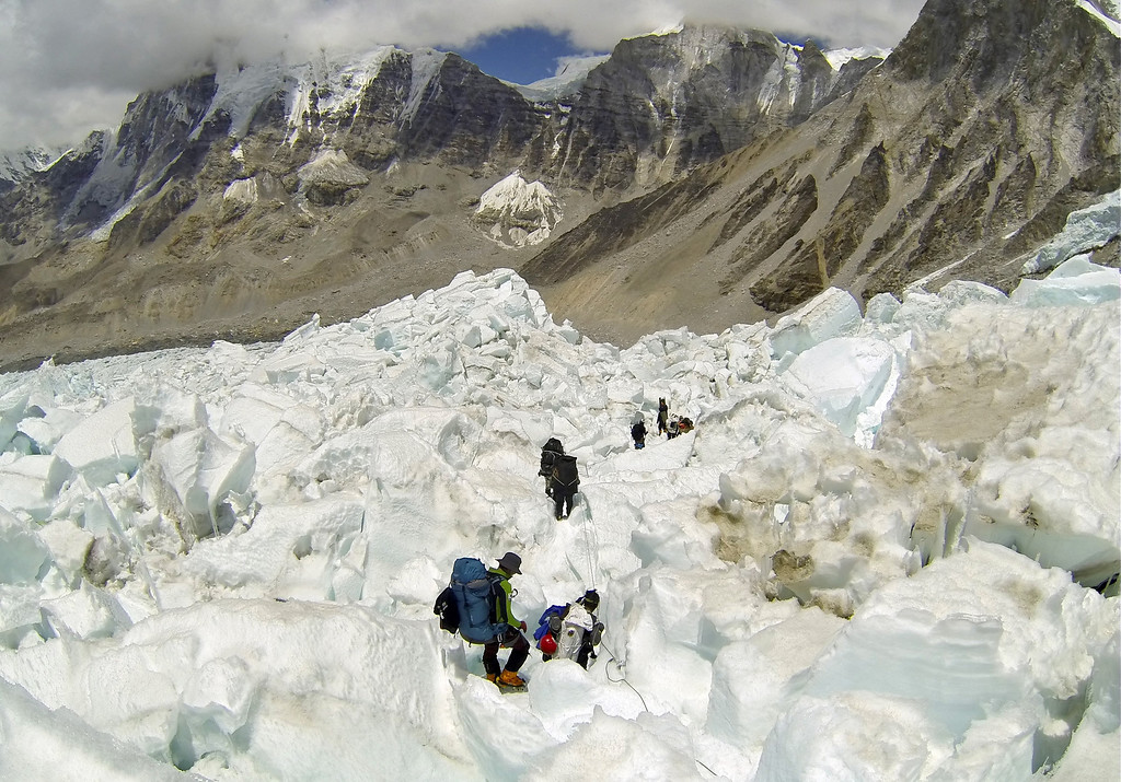 . Climbers from various countries descend Khumbu Icefall on their way back to Base Camo after summiting the 8,850-meter (29,035-foot) Mount Everest on May 22, 2013.   (AP Photo/ Pasang Geljen Sherpa)