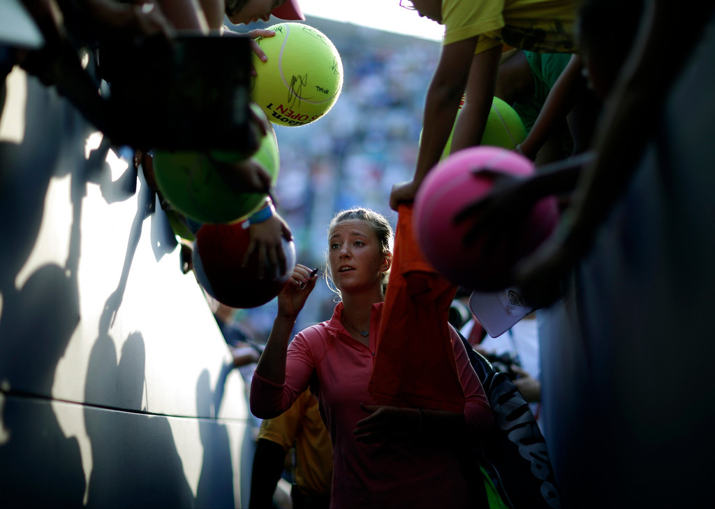 . Victoria Azarenka, of Belarus, signs autographs for fans during the second round of the 2013 U.S. Open tennis tournament, Thursday, Aug. 29, 2013, in New York. (AP Photo/David Goldman)