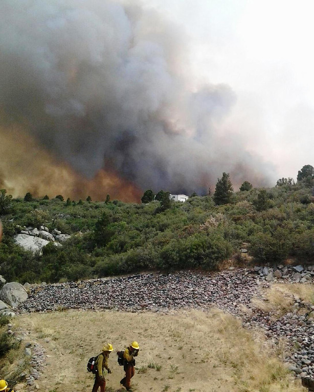 . Firefighters work near a wildfire burning along a ridge in Yarnell, Ariz., in this photo provided by the U.S. Forest Service, Monday, July 1, 2013.  (AP Photo/U.S. Forest Service)