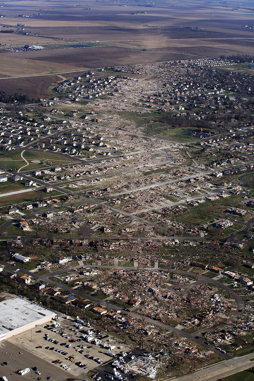 . Tornado damaged homes are seen on November 18, 2013 in Washington, Illinois. According to reports the tonado that ripped across Washington, Illinois has been preliminary classified as an EF-4. A fast-moving storm system that spawned multiple tornadoes which touched down across the Midwest, leaving behind a path of destruction in 12 states and killing at least five.  (Photo by Tasos Katopodis/Getty Images)