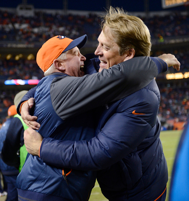 . Denver Broncos head coach John Fox gets a hug from defensive coordinator Jack Del Rio as the Denver Broncos took on the Kansas City Chiefs at Sports Authority Field at Mile High in Denver, Colorado on December 30, 2012. Team sources say it is expected that operations director John Elway will name Del Rio as interim head coach while John Fox undergoes heart surgery.  (Joe Amon/The Denver Post)