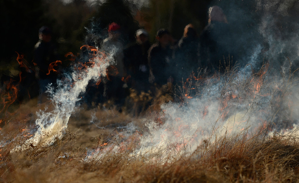 . DENVER, CO. - MARCH 07:  People watch a controlled burn at the Denver Botanic Gardens, March, 07, 2013. Fires are a natural part of the plains ecology and help balance the diversity of species. The burn will aid in the germination and growth of different species in the garden. (Photo By RJ Sangosti/The Denver Post)