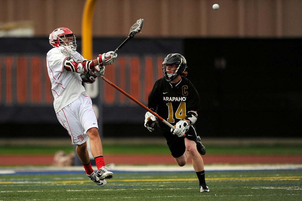 . DENVER, CO - MAY 15: Regis Jesuit junior midfielder Aaron Horvat #3 passes against Regis Jesuit senior longstick midfielder JD Hall #14 during a CHSAA 5A boys lacrosse semifinal game on May 15, 2013, in Denver, Colorado. Arapahoe won 13-5 to advance to the finals. (Photo by Daniel Petty/The Denver Post)