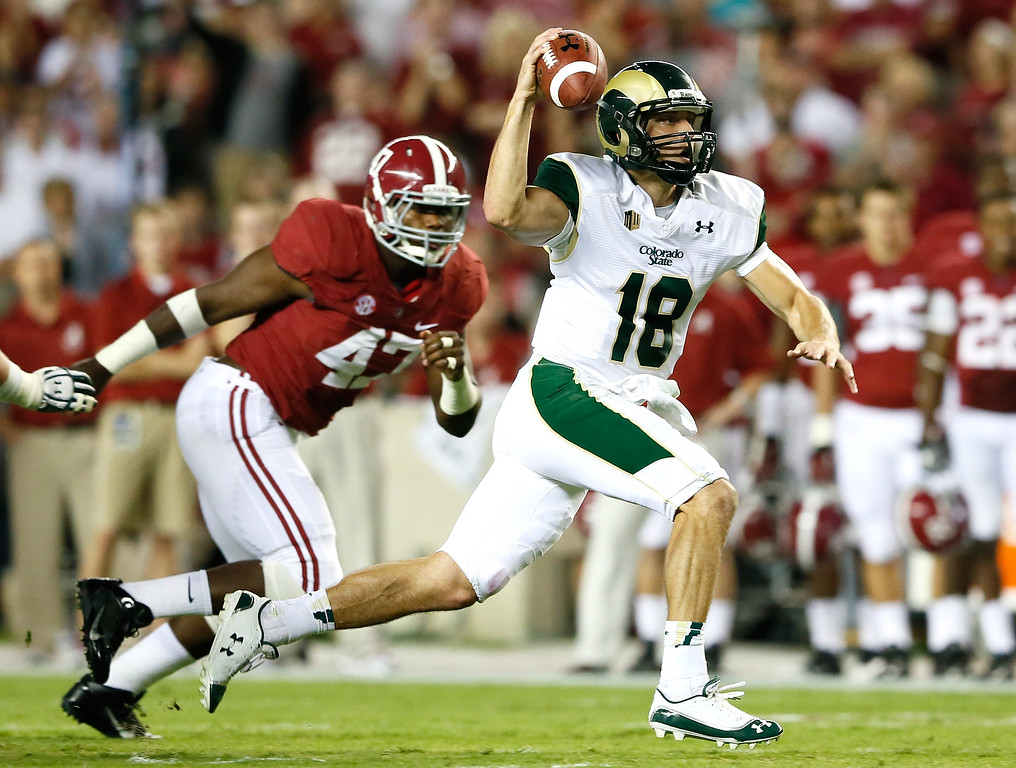 . TUSCALOOSA, AL - SEPTEMBER 21:  Garrett Grayson #18 of the Colorado State Rams rushes upfield away from Xzavier Dickson #47 of the Alabama Crimson Tide at Bryant-Denny Stadium on September 21, 2013 in Tuscaloosa, Alabama.  (Photo by Kevin C. Cox/Getty Images)