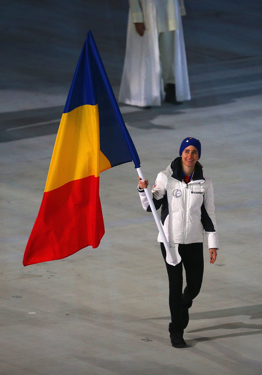 . Laura Valenau  of Romania flag bearer during the Opening Ceremony of the Sochi 2014 Paralympic Winter Games at Fisht Olympic Stadium on March 7, 2014 in Sochi, Russia.  (Photo by Hannah Peters/Getty Images)