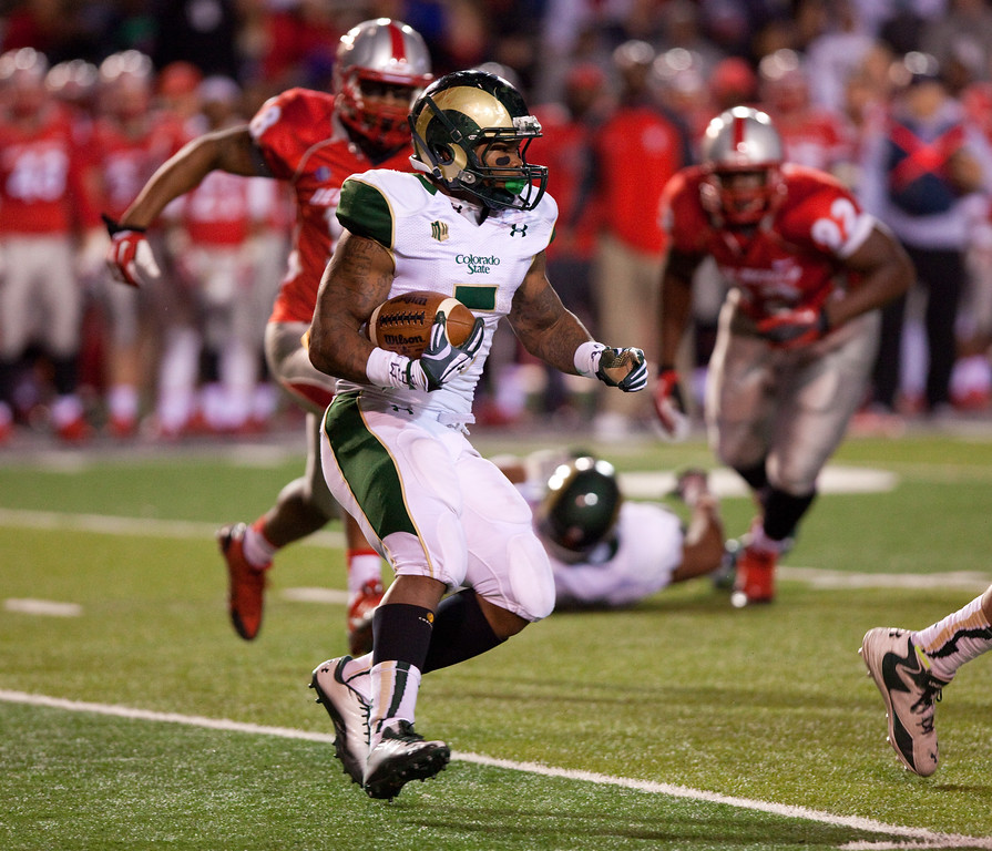 . Colorado State running back Kapri Bibbs runs against New Mexico in the first half of an NCAA college football game on Saturday, Nov. 16, 2013, in Albuquerque, N.M. (AP Photo/Eric Draper)