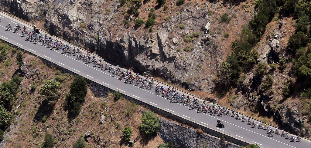 . The pack of riders cycles on its way during the 156 km second stage of the centenary Tour de France cycling race from Bastia to Ajaccio, on the French Mediterranean island of Corsica June 30, 2013.         REUTERS/Pascal Pochard Casabiana/Pool