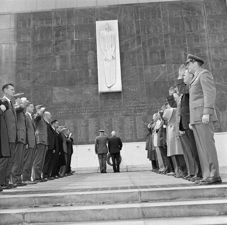 . FILE - In this April 19, 1963 file photo, Gen. Jimmy Doolittle, right center, stands in a moment of silent prayer with Brig. Gen. John A. Hilger after laying a wreath at a Seattle memorial for World War II dead. Doolittle, who led the war�s first bombing raid on Tokyo 21 years ago, arrived in Seattle to join 25 of his raiders, standing in salute during the ceremony, for their 21st annual reunion.  Thousands of visitors streamed to the national Air Force museum on Saturday, Nov. 9, 2013 to pay a Veterans Day weekend tribute to the few surviving members of the Doolittle Raiders, airmen whose daring raid on Japan helped boost American morale during World War II, as they planned to make their ceremonial final toast together.  Only four of the 80 Raiders are still living, and one was unable to attend because of health issues. (AP Photo)