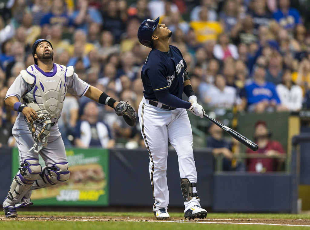 . Carlos Gomez #27 of the Milwaukee Brewers pops up as catcher Wilin Rosario #20 of the Colorado Rockies follows the ball at Miller Park on June 26, 2014 in Milwaukee, Wisconsin.  (Photo by Tom Lynn/Getty Images)