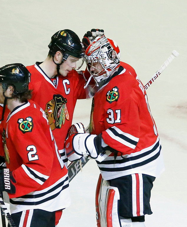 . Chicago Blackhawks center Jonathan Toews, left, and goalie Antti Raanta celebrate the Blackhawks\' 7-2 win over the Colorado Avalanche after an NHL hockey game Friday, Dec. 27, 2013, in Chicago. (AP Photo/Charles Rex Arbogast)