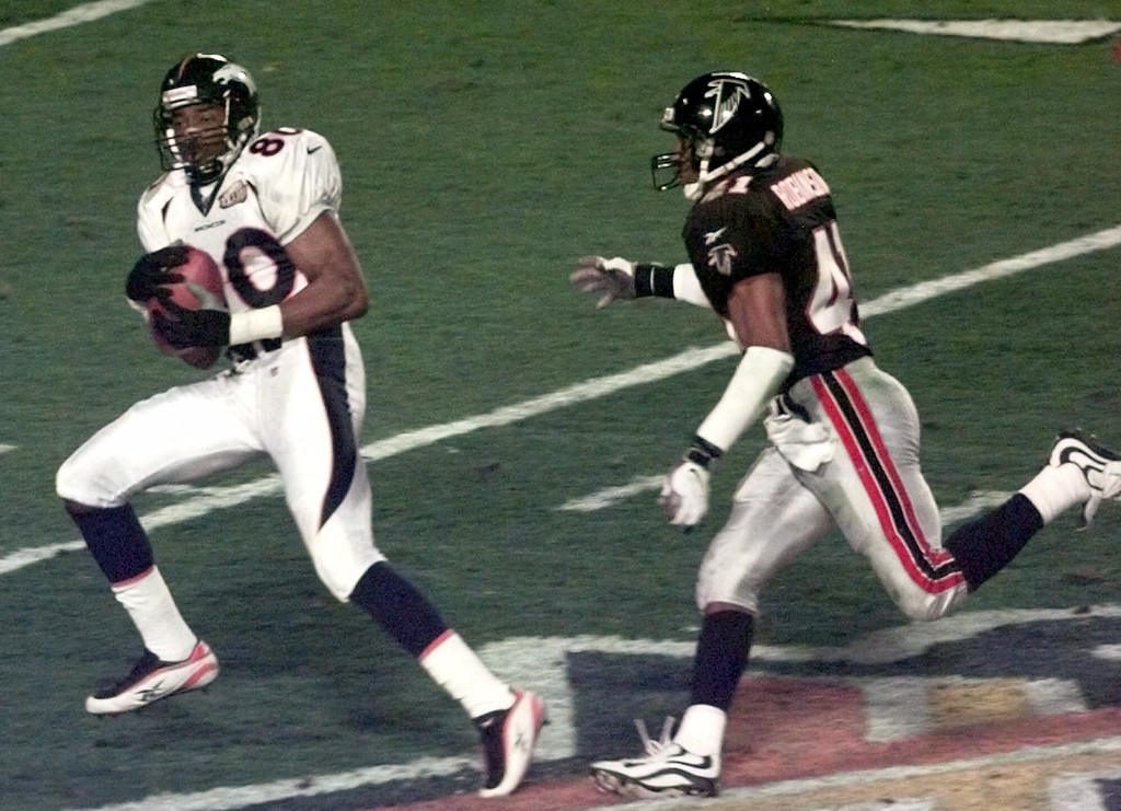 . Denver Broncos wide receiver Rod Smith (80) catches an 80-yard touchdown pass from quarterback John Elway as Atlanta Falcons safety Eugene Robinson (41) defends in the second quarter of Super Bowl XXXIII, in Miami, Jan. 31, 1999. (AP Photo/Mark Duncan)