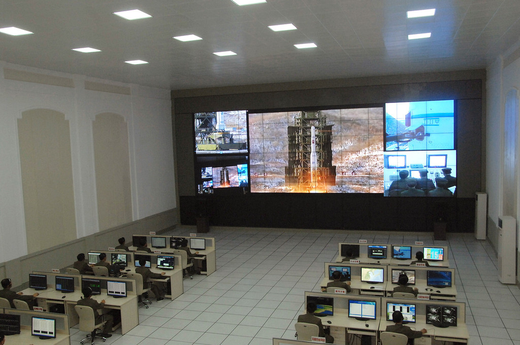 . Scientists and technicians at the General Satellite Control and Command Center on the outskirts of Pyongyang watch the launch of the Unha-3 rocket from a launch site on the west coast, in the village of Tongchang-ri, about 56 kilometers (35 miles) from the Chinese border city of Dandong, North Korea, Wednesday, Dec. 12, 2012. North Korea successfully fired the long-range rocket on Wednesday, defying international warnings as the regime of Kim Jong Un took a big step forward in its quest to develop a nuclear missile. (AP Photo)