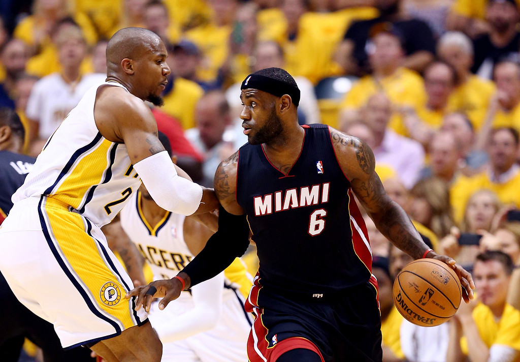 . INDIANAPOLIS, IN - MAY 28: LeBron James #6 of the Miami Heat controls the ball as David West #21 of the Indiana Pacers defends during Game Five of the Eastern Conference Finals of the 2014 NBA Playoffs at Bankers Life Fieldhouse on May 28, 2014 in Indianapolis, Indiana.  (Photo by Andy Lyons/Getty Images)