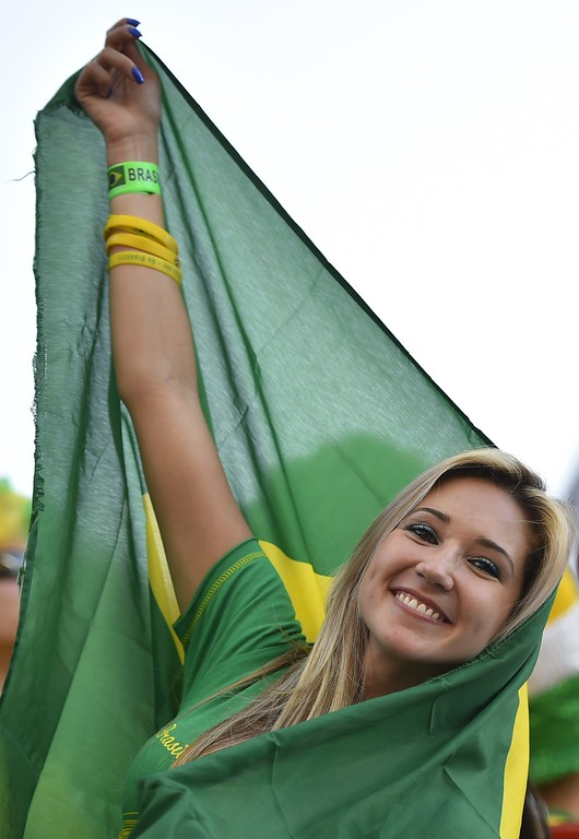 . Brazilian fans pose prior to the Group A football match between Brazil and Croatia at the Corinthians Arena in Sao Paulo during the 2014 FIFA World Cup on June 12, 2014.  AFP PHOTO / FABRICE COFFRINI/AFP/Getty Images