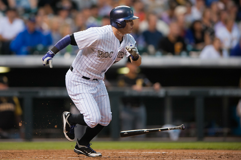 . Corey Dickerson #6 of the Colorado Rockies hits an RBI groundout in the fifth inning of a game against the Pittsburgh Pirates at Coors Field on July 26, 2014 in Denver, Colorado.  (Photo by Dustin Bradford/Getty Images)