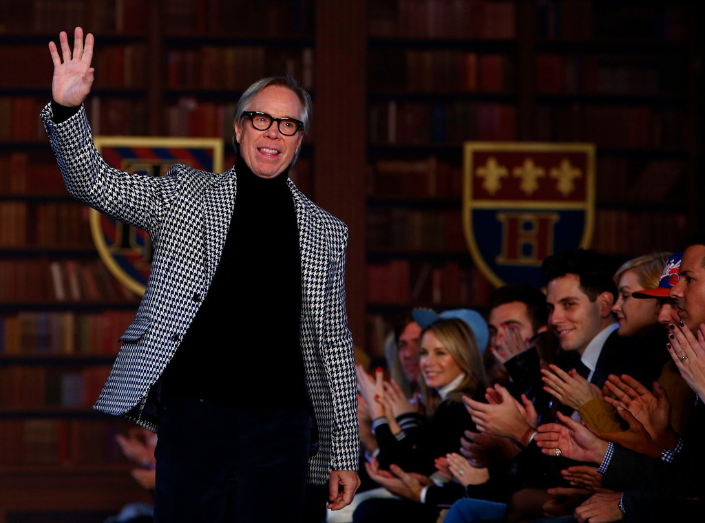 . Designer Tommy Hilfiger greets the audience after a presentation of his Men\'s Autumn/Winter 2013 collection during New York Fashion Week, February 8, 2013. REUTERS/Eric Thayer