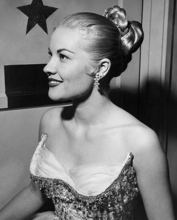 . A braided chignon decorated with jeweled clips, gives the illusion of long hair to TV and recording star Patti Page, April 11, 1957. The hairdo was created for her by hair stylist Ernest Adler. (AP Photo)