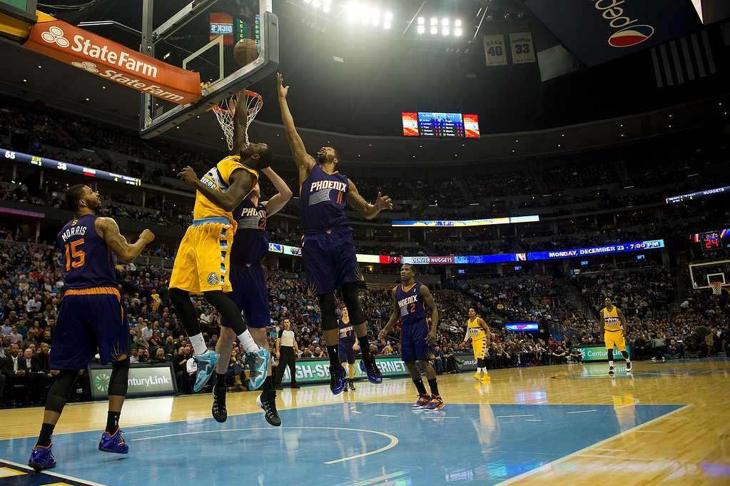 . DENVER, CO - DECEMBER 20: The Denver Nuggets take on the Phoenix Suns during the third quarter at the Pepsi Center on December 20, 2013, in Denver, Colorado. (Photo by Daniel Petty/The Denver Post)