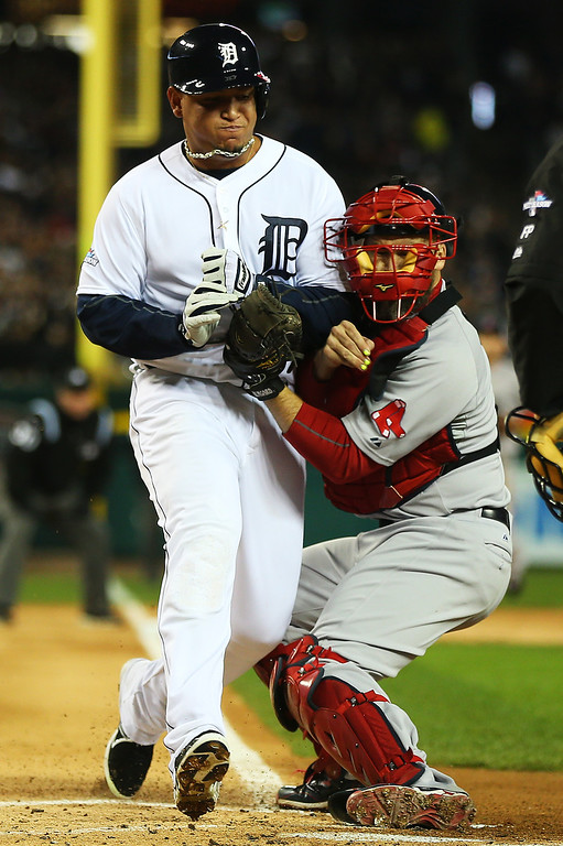 . Miguel Cabrera #24 of the Detroit Tigers is out at home by David Ross #3 of the Boston Red Sox on a single by Jhonny Peralta #27 of the Detroit Tigers in the first inning of Game Five of the American League Championship Series at Comerica Park on October 17, 2013 in Detroit, Michigan.  (Photo by Mike Ehrmann/Getty Images)