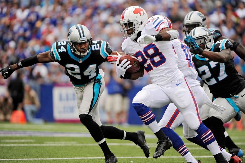. Buffalo Bills running back C.J. Spiller (28) runs the ball against Carolina Panthers cornerback Josh Norman (24) in the second quarter of an NFL football game Sunday, Sept. 15, 2013, in Orchard Park, N.Y. (AP Photo/Gary Wiepert)