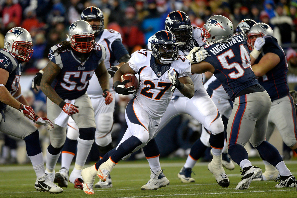 . Running back Knowshon Moreno #27 of the Denver Broncos gains yards vs the New England Patriots at Gillette Stadium in Foxborough MA, November 24, 2013 Denver. (Photo By Joe Amon/The Denver Post)