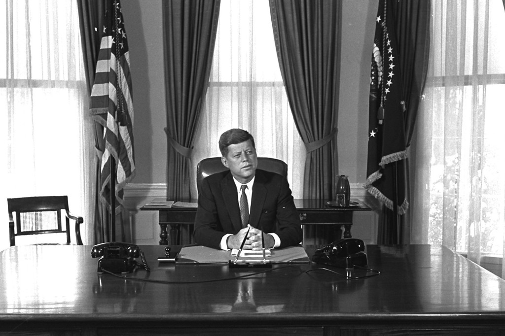 . Newly-elected President Kennedy posed for first pictures at his White House desk, January 21, 1961, before plunging into a busy round of conferences.  (AP Photo/Bill Achatz)