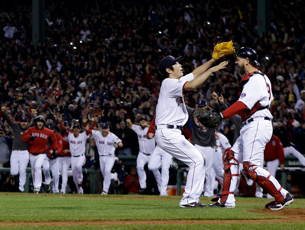 . Boston Red Sox relief pitcher Koji Uehara and catcher David Ross celebrate after getting St. Louis Cardinals\' Matt Carpenter to strike out and end Game 6 of baseball\'s World Series Wednesday, Oct. 30, 2013, in Boston. The Red Sox won 6-1 to win the series. (AP Photo/Matt Slocum)