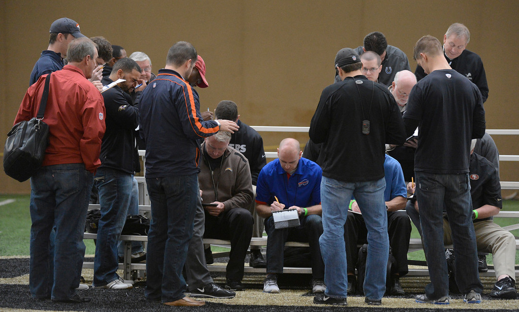 . BOULDER, CO. - MARCH 13:  NFL scouts gather to share information with each other after watching players preform drills during pro days, March, 13, 2013. The scouts watch players from the University of Colorado in Boulder. (Photo By RJ Sangosti/The Denver Post)
