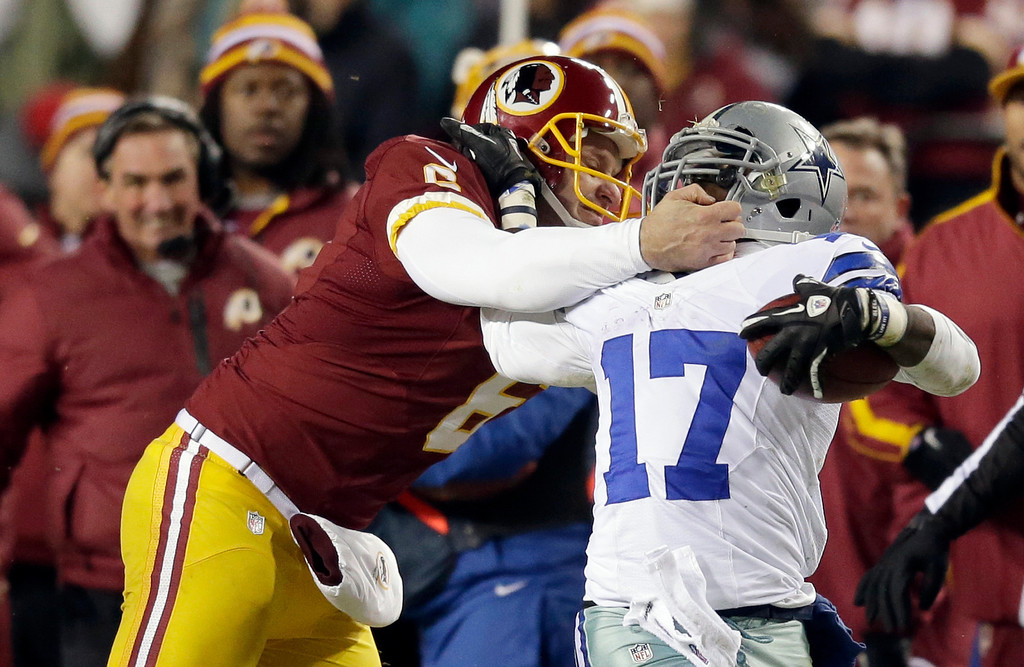 . Washington Redskins punter Sav Rocca (6) tackles Dallas Cowboys\' Dwayne Harris (17) during the second half of an NFL football game Sunday, Dec. 30, 2012, in Landover, Md. Rocca was called for a penalty on the play. (AP Photo/Evan Vucci)
